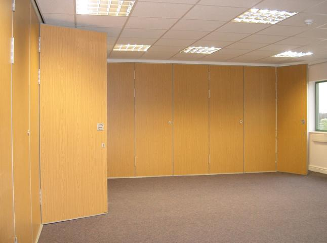 Multifold sliding folding partition Type M80 showing full height pass door