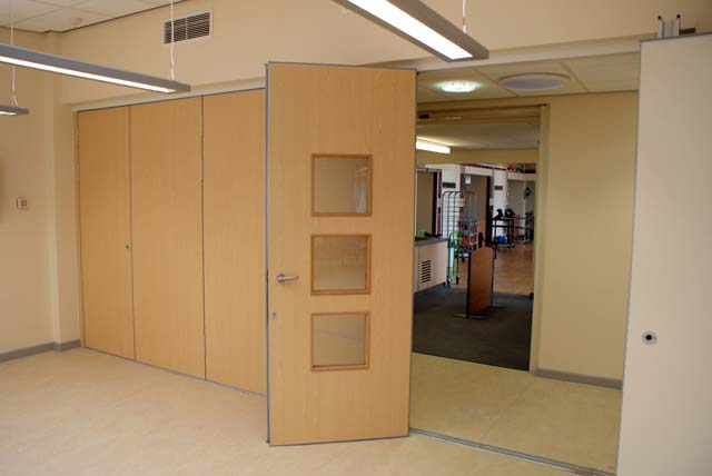Multifold sliding folding partition M80 with passdoor with vision panels