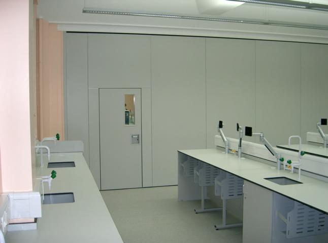 Acoustic movable wall Type 110C with inset pass door and vision panel